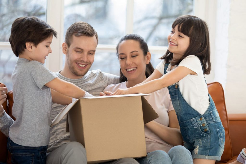 family opening box with custom product inside